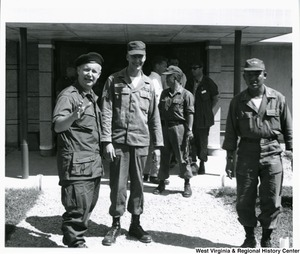 Congressman Arch A. Moore, Jr. with Army Sergeant Robert Edwards, of the 99th Advisory team, 25th infantry division, in Duc Hoa district of Long An Providence, Vietnam. Edwards is from Four States, W.Va.