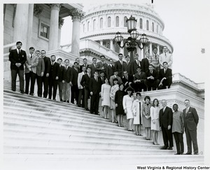 Congressman Arch A. Moore, Jr. (third from right) standing on the steps of the Capitol building with Bethany College Political Science students.