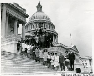 Congressman Arch A. Moore, Jr. standing on the steps of the Capital with a class from Jane Lew High School.