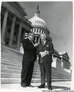 Congressman Arch A. Moore, Jr (right) standing on the steps of the Capitol with Harry Arthur.