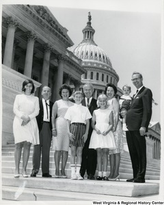 Congressman Arch A. Moore, Jr. with his wife Shelley on the steps of the Capitol with an unidentified family of seven.