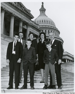 Congressman Arch A. Moore, Jr standing with his wife, Shelley, and an unidentified family of five on the steps of the Capitol.