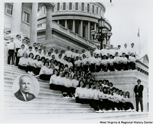 A large unidentified group of men and women sitting on the steps of the Capitol. They are wearing a uniform of white shirts and black pants. A portrait of Congressman Arch A. Moore, Jr. has been added to the corner of the photograph.