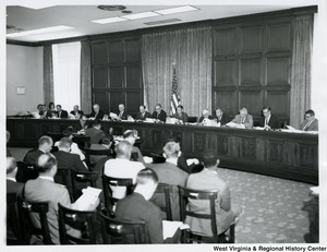 Congressman Arch A. Moore, Jr. at a hearing with other congressmen.
