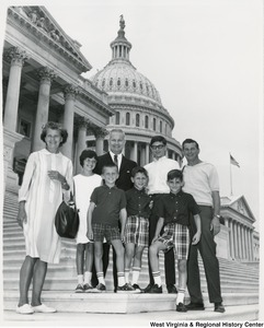 Congressman Arch A. Moore, Jr. standing on the steps of the Capitol with the Sagon family, Richard, Brian, Claude, and Nogay.