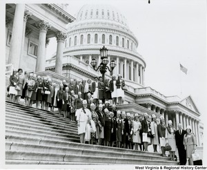 Congressman Arch A. Moore, Jr. standing on the steps of the Capitol with a group of Lady Shriners from West Virginia.