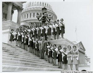 Congressman Arch A. Moore, Jr. standing on the steps of the Capitol with the Fairmont Girl Scouts Troop 110.