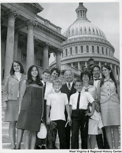 Congressman Arch A. Moore, Jr. (center, back) standing on the steps of the Capitol with the Lauffer and Murandy? families.