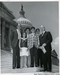 Congressman Arch A. Moore, Jr. (right) standing on the steps of the Capitol with Dr. and Mrs. Robert Lewine and his three children.