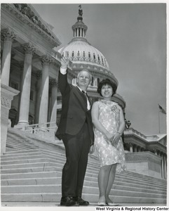 Congressman Arch A. Moore, Jr. standing on the steps of the Capitol with an unidentified woman.