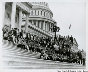 Congressman Arch A. Moore, Jr. standing on the steps of the Capitol with the Wheeling Auto Club School Boy Patrol.