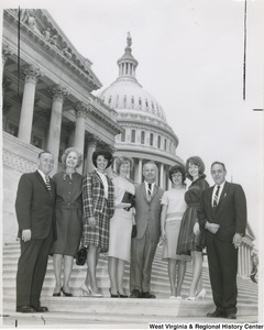 Congressman Arch A. Moore, Jr. standing on the steps of the Capitol with five unidentified women and two unidentified men.