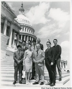 Congressman Arch A. Moore, Jr. (center) standing on the steps of the Capitol with a group of people from Salem College.
