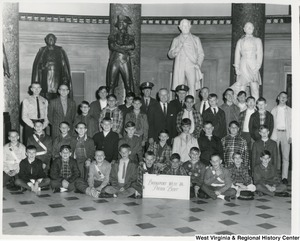 Congressman Arch A. Moore, Jr. (center) with the Bridgeport School Boys Patrol in the Statuary Hall at the Capitol. Moore is flanked by Bridgeport Police Chief John H. Diamond and Thomas D. Kinney. The second statue from the right is that of Francis H. Pierpont, first governor of the restored government of Virginia who was elected to that post in 1861 by delegates at the Wheeling Constitutional Assembly.