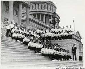The Oak Glen High School Band (New Cumberland, W.Va.) sitting on the steps of the Capitol building.