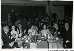 Congressman Arch A. Moore, Jr. sitting with a group of unidentified people at the 100 Years of Republican National Convention Celebration.
