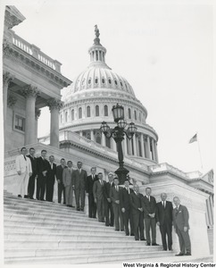 Congressman Arch A. Moore, Jr. standing on the steps of the Capitol with employees of the People's Life Insurance Company (Fairmont, W. Va.).