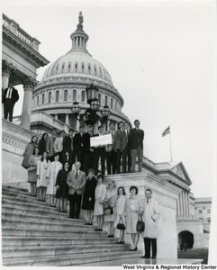 Congressman Arch A. Moore, Jr. standing on the steps of the Capitol with Bridgeport High School students.