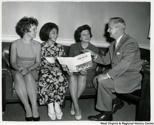 Congressman Arch A. Moore, Jr., Mrs. Shelley Moore,  Mrs. Susan Wilkes, and Emiko Chiba discussing the Sing-Out of 1966.