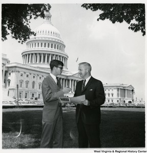 Congressman Arch A. Moore, Jr. standing on the lawn of the Capitol talking to Lawrence Crawford.