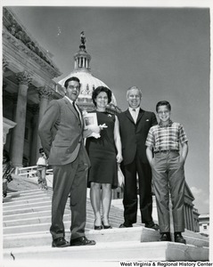 Congressman Arch A. Moore, Jr. standing on the steps of the Capitol with Silvia G. Paesani and her family.