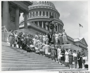 Congressman Arch A. Moore, Jr. with thirty-four members of the Marion County Homemakers Club. The ladies were taken on a tour by a member of Moore's staff, Thomas Haack (seated).