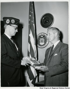 "Herald String, National Legislative Director of the American Legion (left), presenting a copy of ""The American Legion Story"" to Congressman Arch A. Moore, Jr."