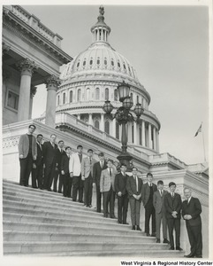 Congressman Arch A. Moore, Jr. standing on the steps of the Capitol with the Clarksburg DeMolay Chapter.