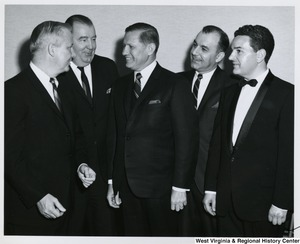Congressman Arch A. Moore, Jr. (far left), and Senator Jennings Randolph (beside Moore), having a conversation with three unidentified men.