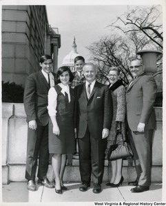 Congressman Arch A. Moore, Jr. standing with Mr. and Mrs. Deleck? and Yanly?. The Capitol can be seen in the background.