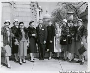 Congressman Arch A. Moore, Jr. (center) with an unidentified group of women. The Capitol dome can be seen in the background.