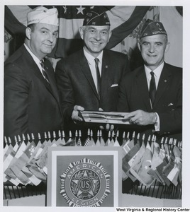 Two unidentified members of the American Legion presenting National Commander John E. Davis with an award at the American Legion Banquet and Dance held at Pleasant Valley Country Club in Weirton, W.Va.