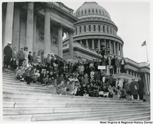 Congressman Arch A. Moore, Jr. standing on the steps of the Capitol with the Marion County School Boy Patrol.