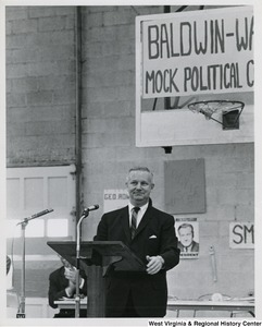 Congressman Arch A. Moore, Jr. standing at a podium at the Baldwin-Wallace University mock political trials.