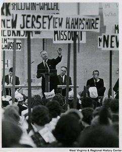 Congressman Arch A. Moore, Jr. speaking to a crowd of students, who are divided by state signs, at the Baldwin-Wallace University mock political trials.