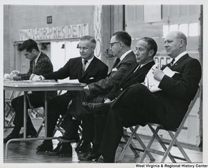 Congressman Arch A. Moore, Jr. sitting with four unidentified men at the Baldwin-Wallace University mock political trials.