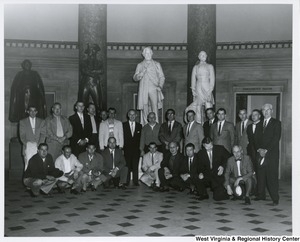 Congressman Arch A. Moore, Jr. (center) with an unidentified group of railroad men. They are in the National Statuary Hall at the Capitol.