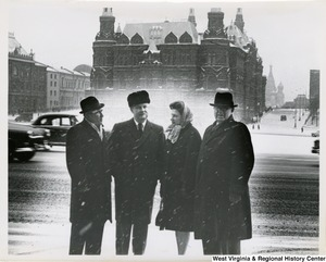 Congressman Arch A. Moore, Jr. standing with his wife, Shelley, and two unidentified men near the Red Square, Moscow, Russia.