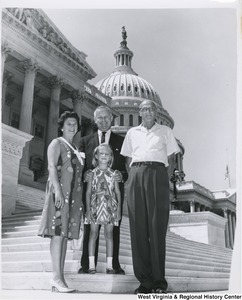 Congressman Arch A. Moore, Jr. standing on the steps of the Capitol with his wife and an unidentified girl and man.