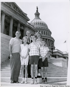 Congressman Arch A. Moore, Jr. standing on the steps of the Capitol with an unidentified family of five.