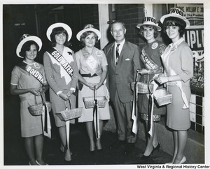 Congressman Arch A. Moore, Jr. with a group of women campaigning for Barry Goldwater, Cecil Underwood, and Moore.
