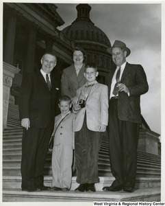 Congressman Arch A. Moore, Jr. on the steps of the Capitol with an unidentified family of four.