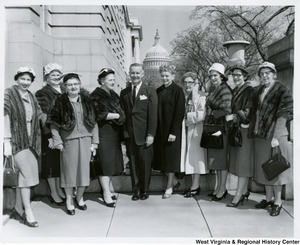 Congressman Arch A. Moore, Jr. (center) standing with an unidentified group of women. The Capitol dome can be seen in the background.