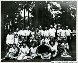 Congressman Arch A. Moore, Jr. with his family and staff. Moore and his wife are seated in the first row. Their daughters Shelley and Lucy are the first two people standing in the second row, left side.  Arch III (Kim) is standing in the second row, first on the right side.